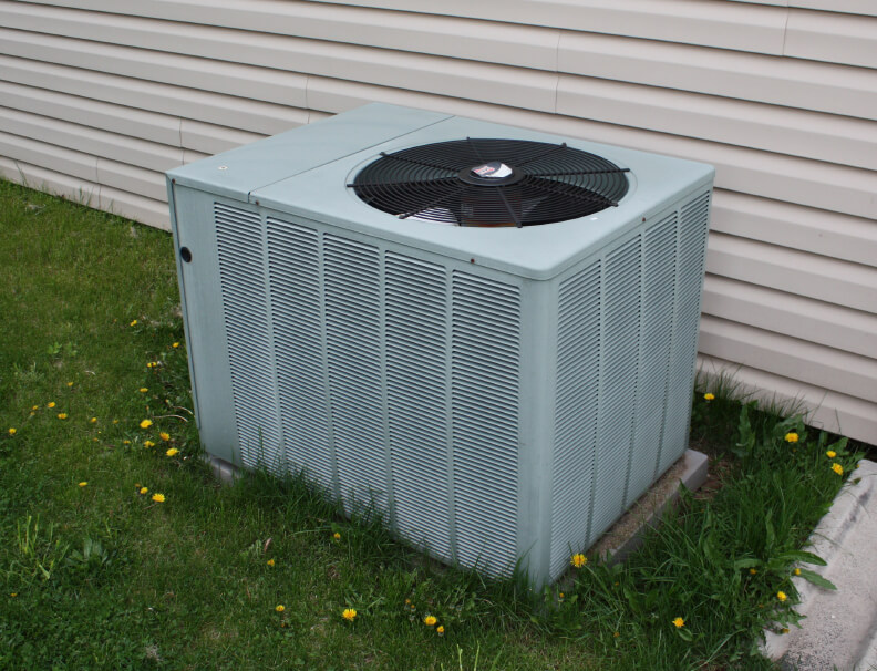 An hvac unit outside of a home.