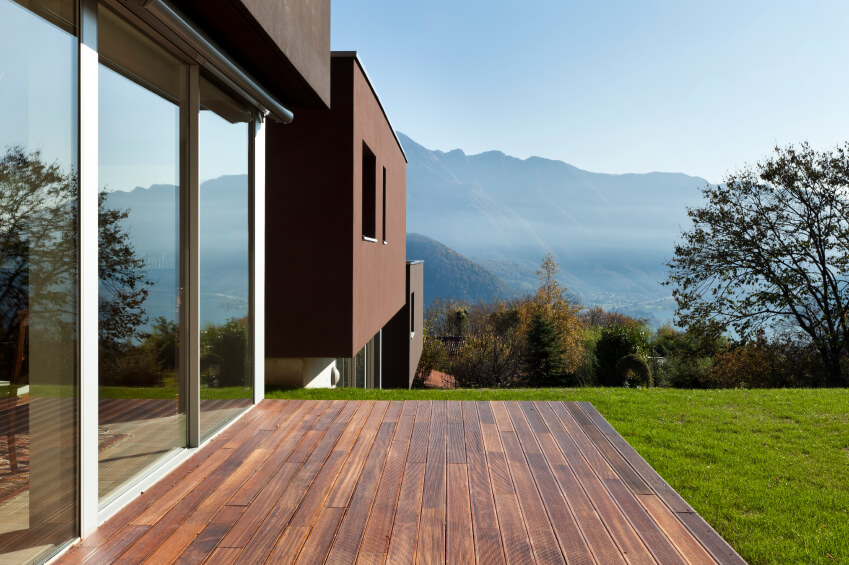 A modern house with a complementary deck.