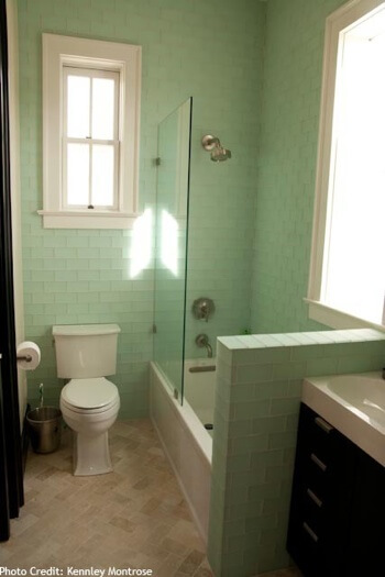 Green glass tile bathroom with tub shower combination