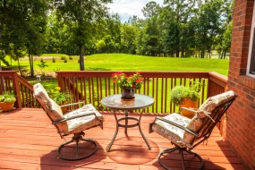 Wood deck with railing.