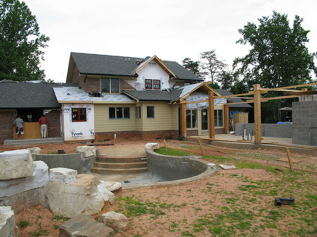 Remodeling exterior pool house. Brock Builders Creative Commons.