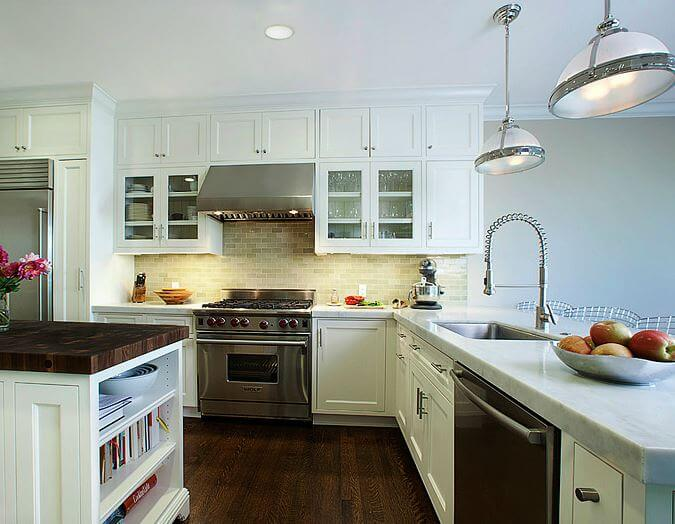 An all-white kitchen with stainless steel appliances