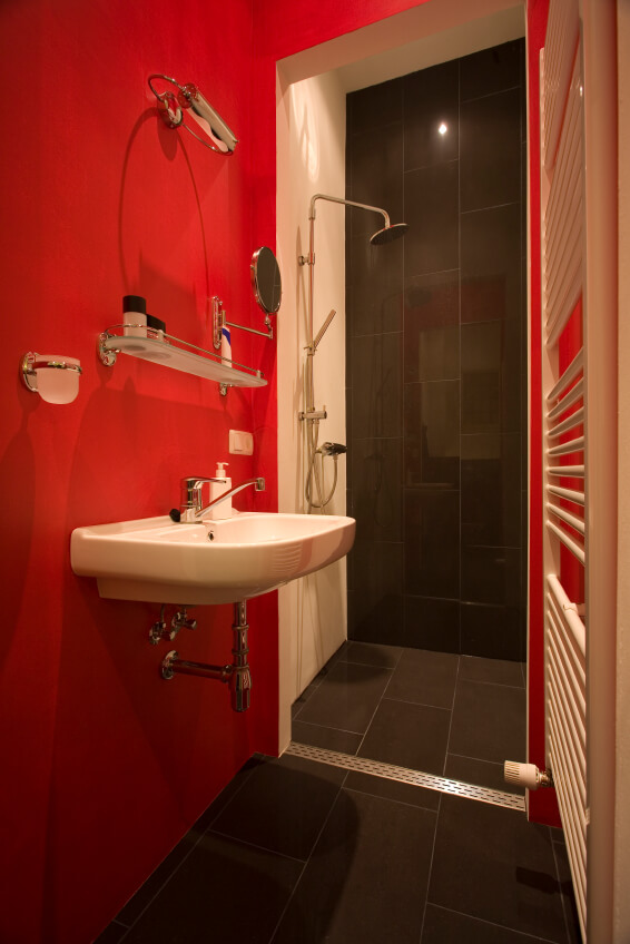 Red modern bathroom with a curbless shower
