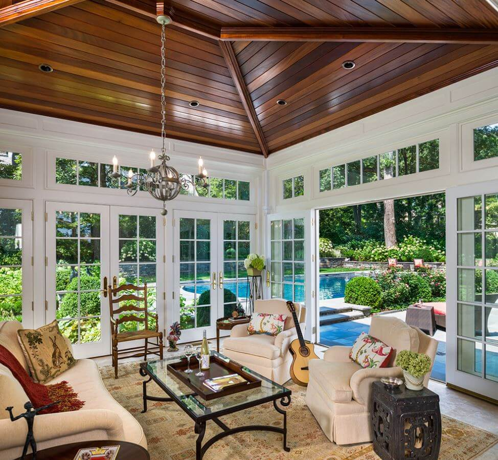 we love how this sunroom has glass doors instead of windows to provide an even more - Sunroom Design Ideas