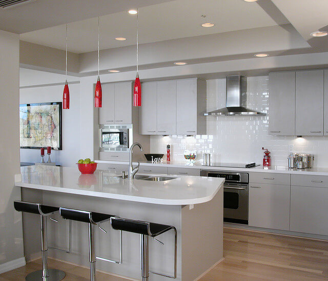 White and red kitchen. Take a look at this classic white subway tile  backsplash treatment in a modern ...