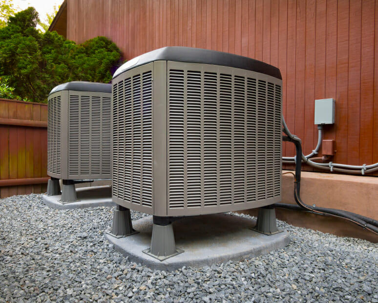 An hvac unit connected to the outside of a home.