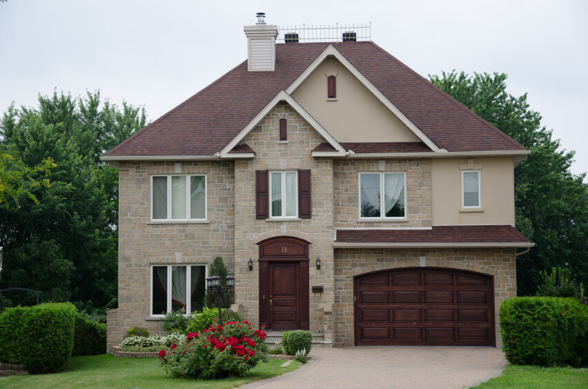 brick home with red garage door