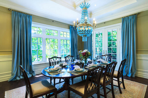 Teal Curtains This Traditional Dining Room Shows Off An Elegant Classic Style The Deep Rich Wood Tones In Floors And Chippendale Table