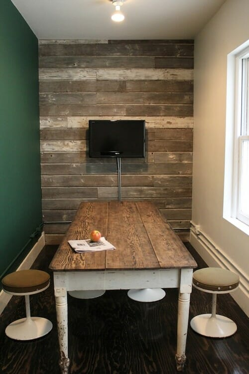 wood accent wall (and the farmhouse table!) at the Ace Hotel in Portland. Via Ace Hotel.