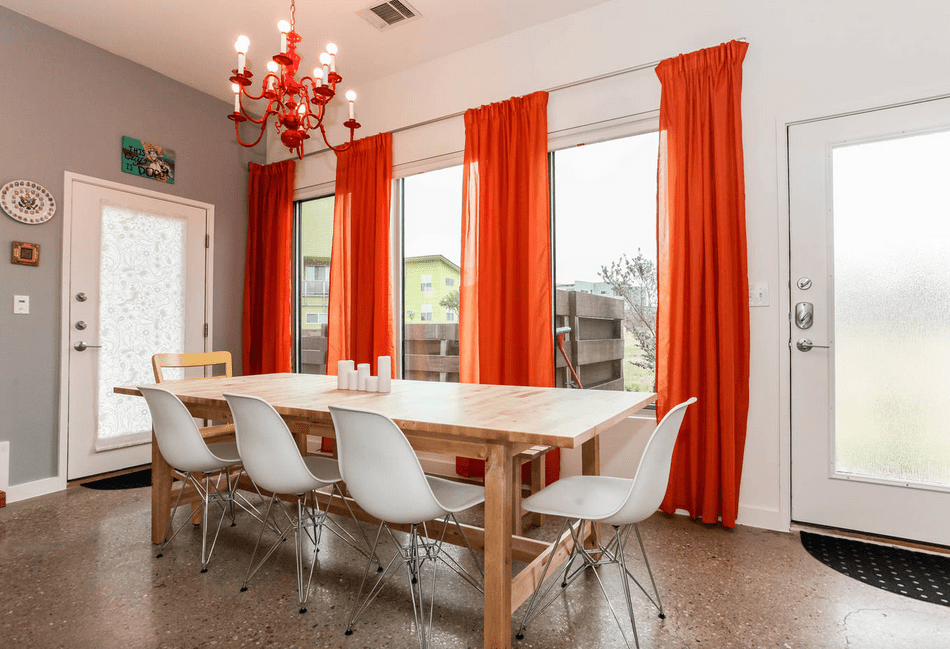 Pops of red and orange dining room