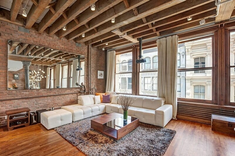 Spacious-living-room-NYC-Loft-in-wood-and-brick_via_Decoist