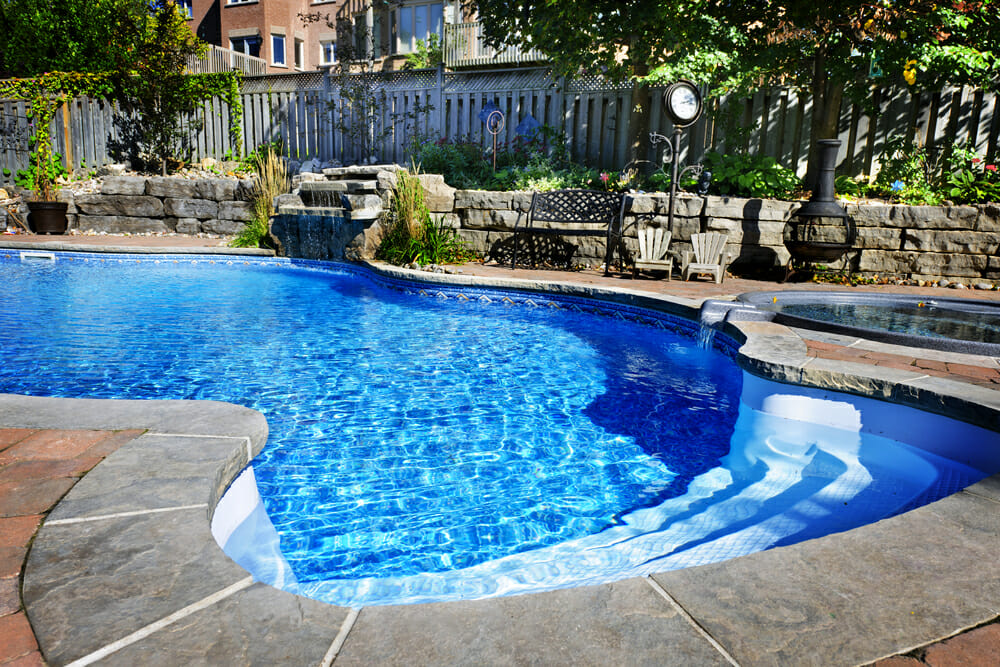 A pool in the backyard of a home.