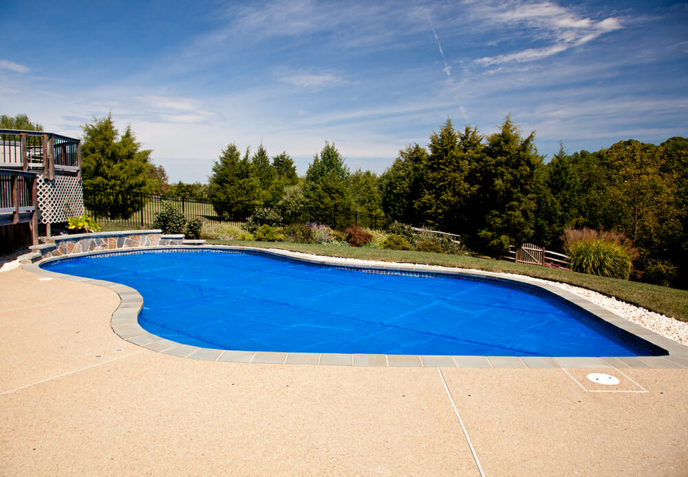 A pool in the backyard of a house.