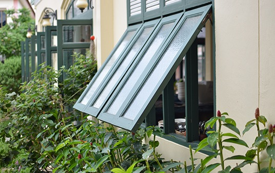 An awning window opening to the outside
