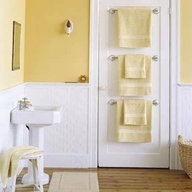 10 creative storage solutions for small bathrooms modernize for Small bathroom towel storage