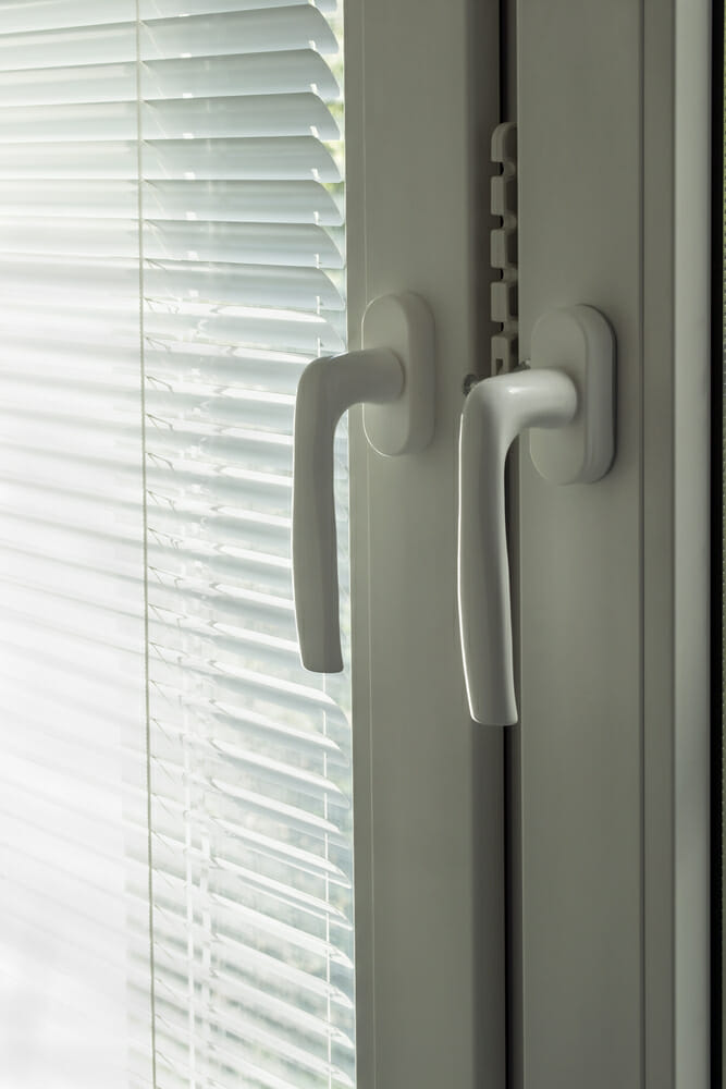 The handles of a casement window