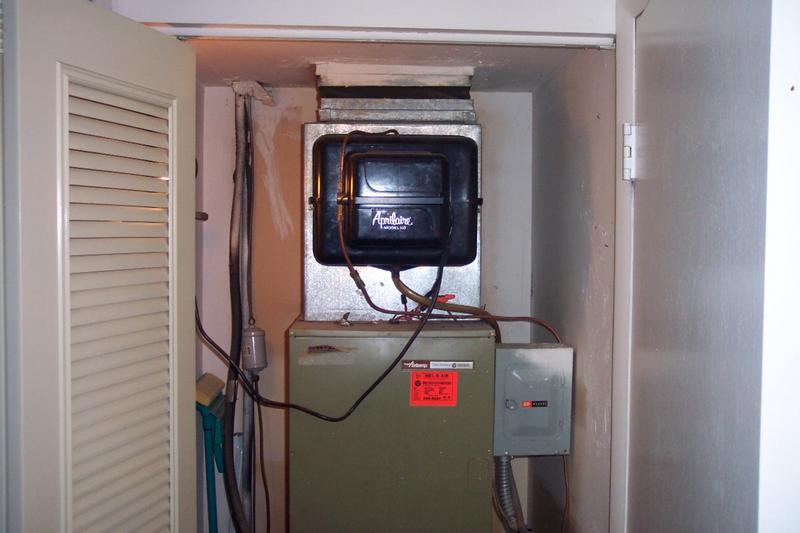 An electric furnace inside the closet of a home.