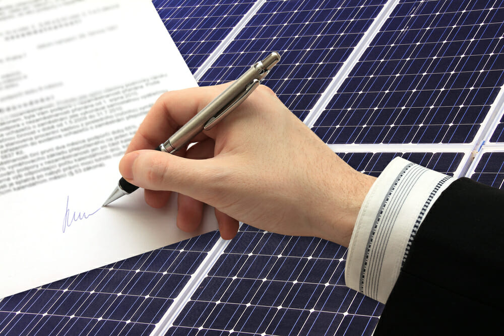 A homeowner signs a solar lease