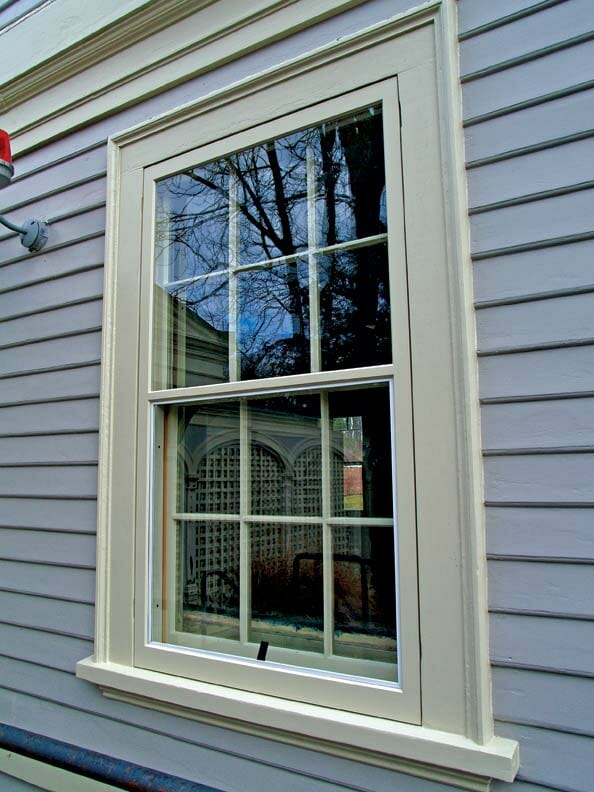 A storm window installed on a home