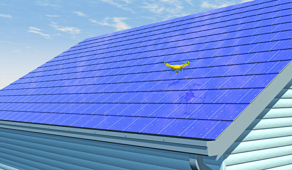Solar shingles on top of a roof.