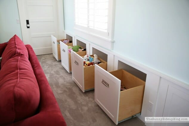 hidden toy drawers provide ample storage
