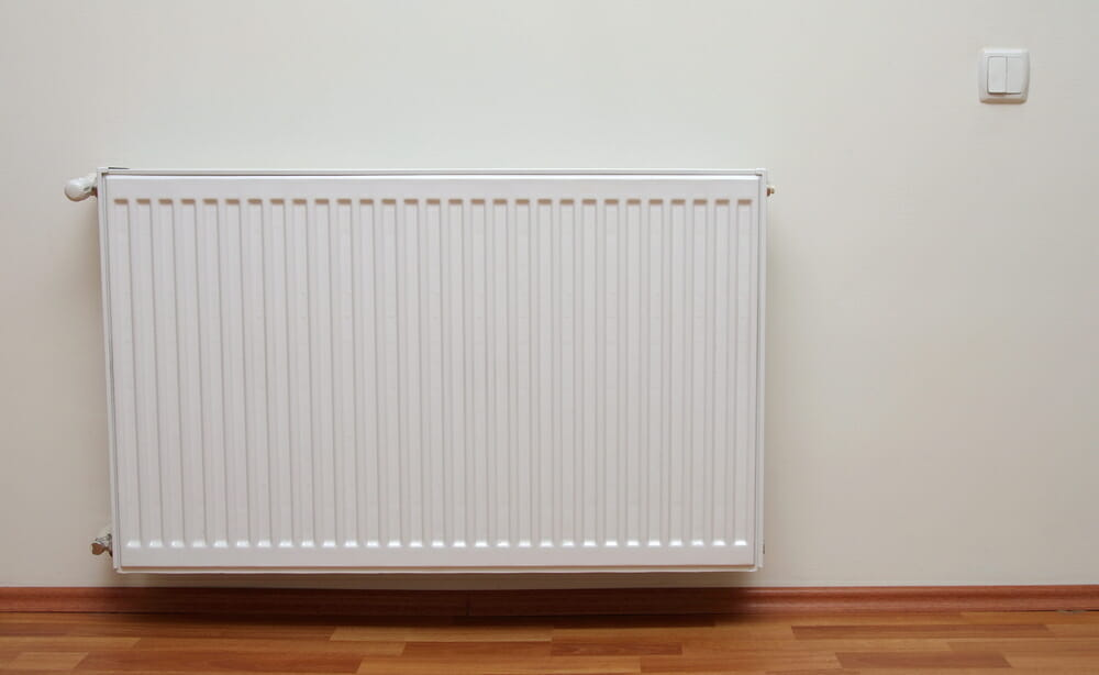 A radiator attached to the wall in a home.