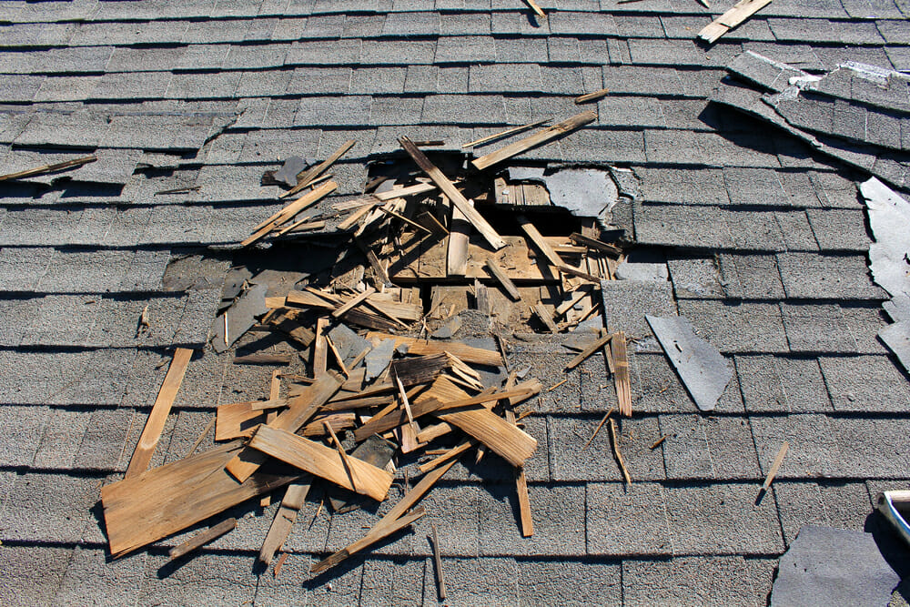 Roof debris on top of a home