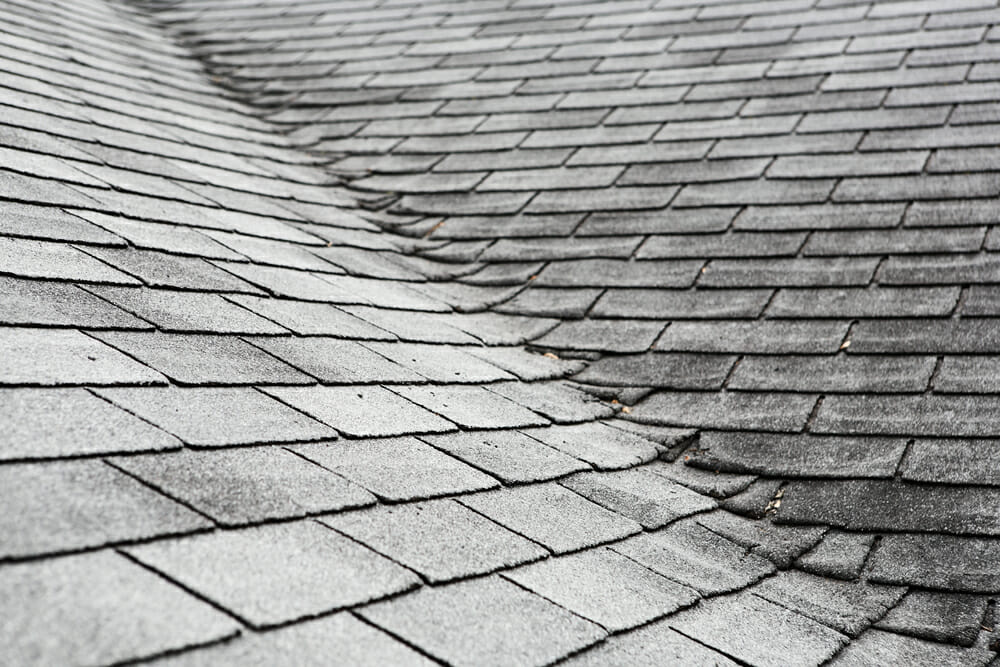 A roof with shingles starting to curl.