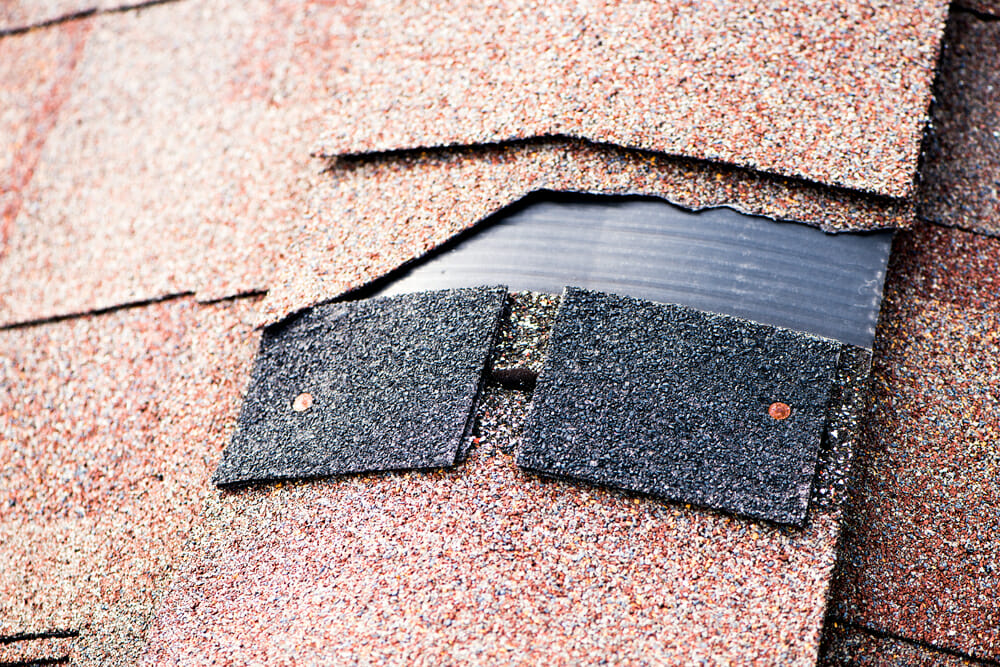 A roof with a shingle missing