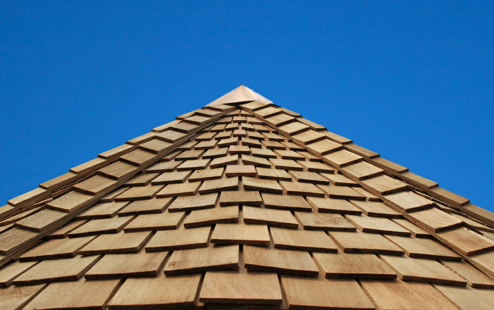 A rooftop that has wood shingles.
