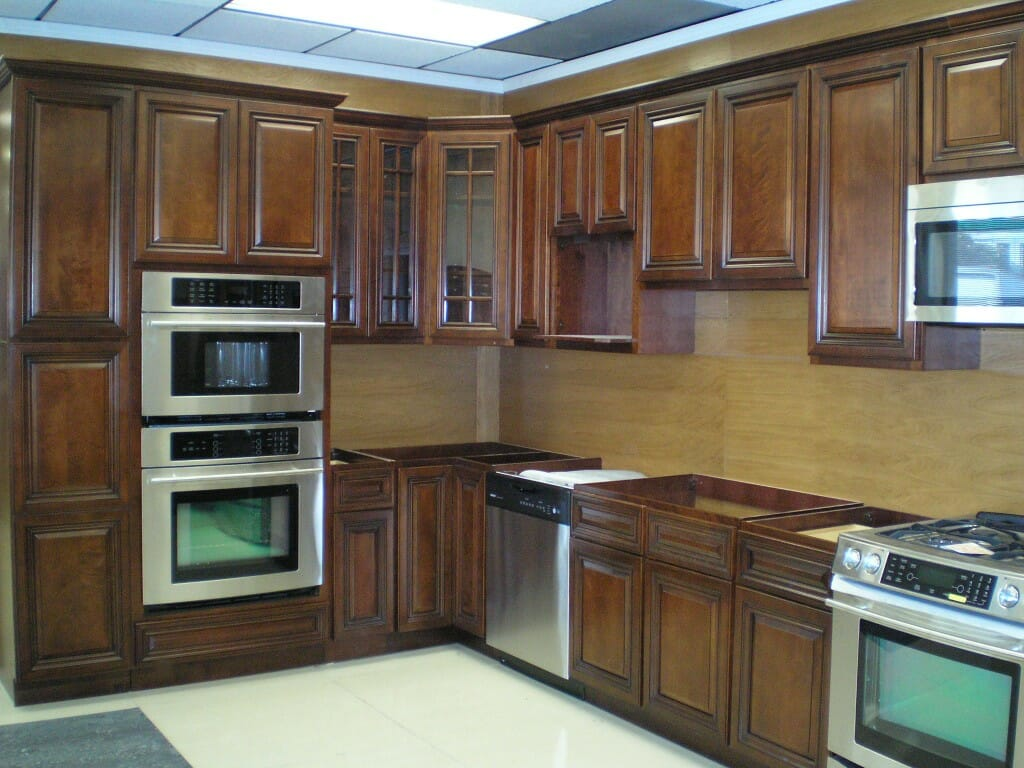 Walnut kitchen cabinets modernize for Walnut kitchen designs