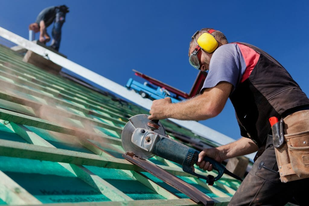 Roofer using handsaw
