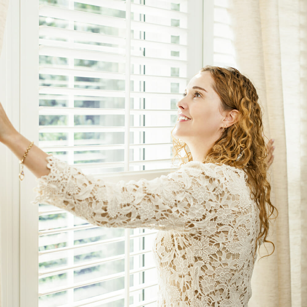woman-opening-blinds