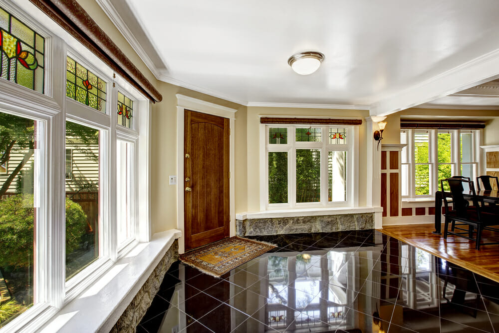 big-windows-with-trim-molding-and-stained-glass-transom