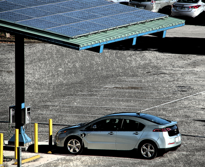 Knoxville, Tennessee USA - November 23, 2015: Chevy Volt electric car at solar charging station.