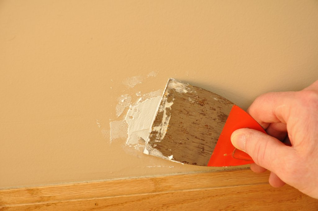 Putty Knite with Spackling Paste to Repair Wall Damage