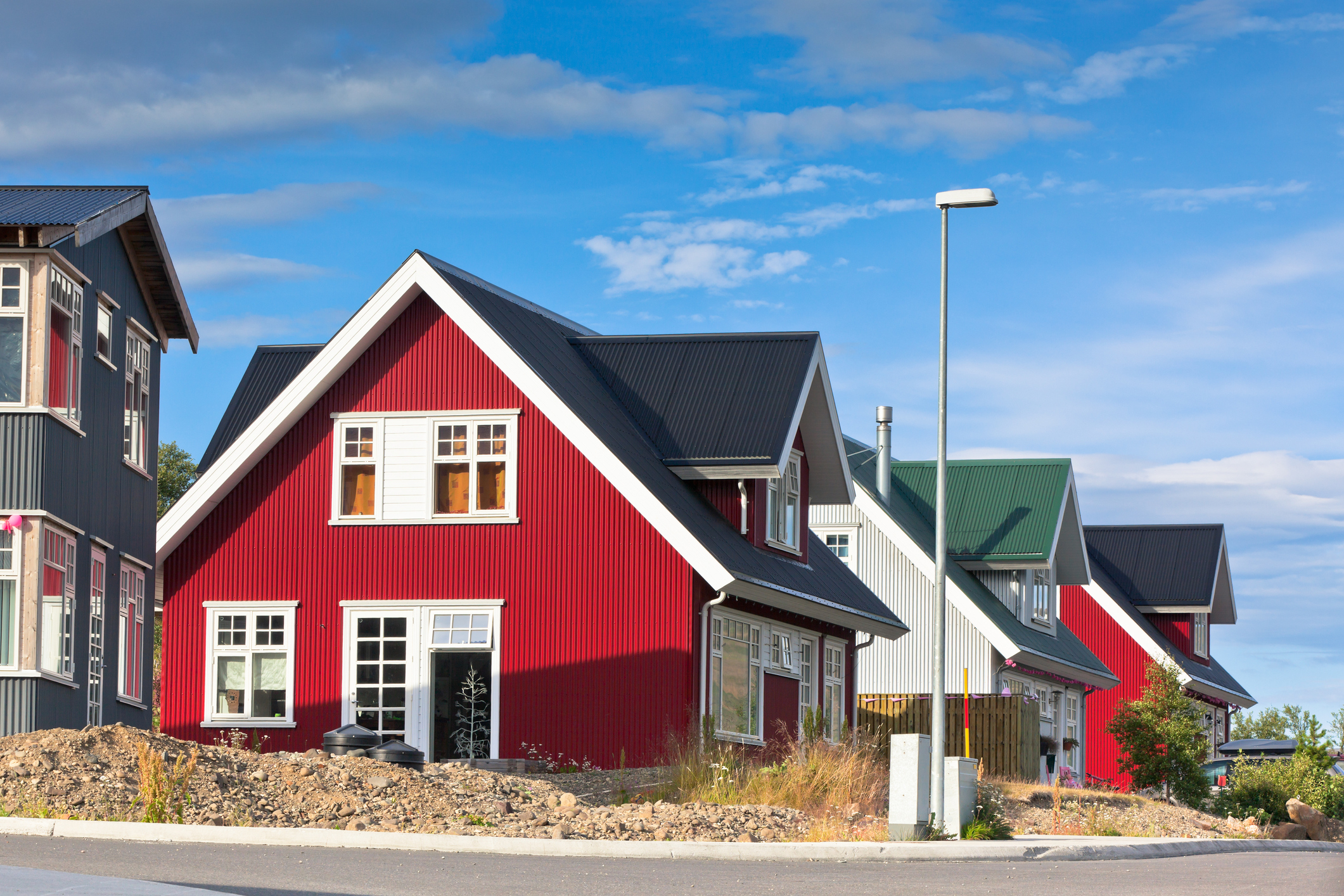 bright siding on a row of houses