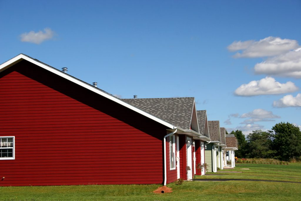 red house with vinyl siding