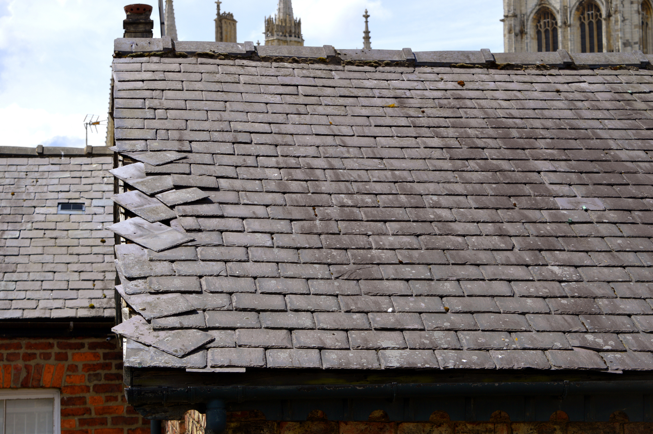 Loose slates on a house roof