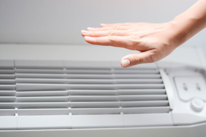 Check air conditioner heat or room temperature