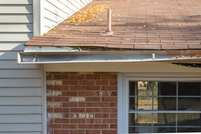 home with damaged gutter system
