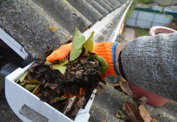 cleaning gutters before storm season