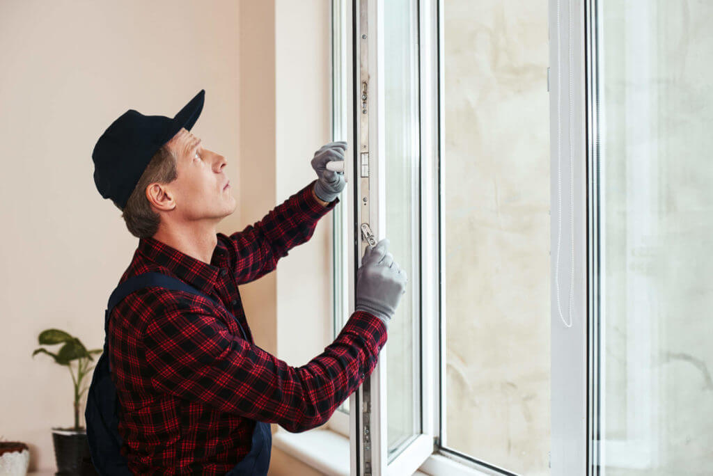 person replacing window